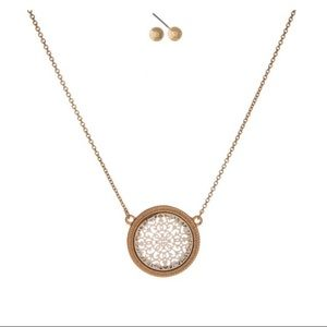 Gold tone pendant necklace with earrings set